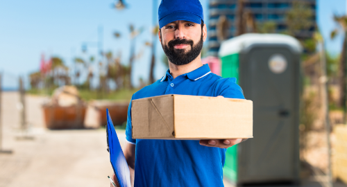 Deliver man holding a prescription parcel